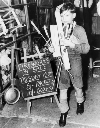 Boy carrying fireworks, 18 October 1949.