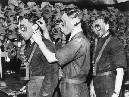 Three men wearing gas masks, c 1930s.