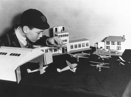 Boy playing with model aeroplanes.