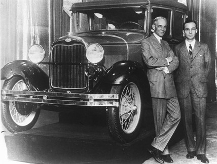 Henry Ford, American car manufacturer, with his son Edsel, c 1920.