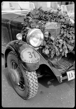 A Mercedes Benz racing car with winner's wreath, c 1934.