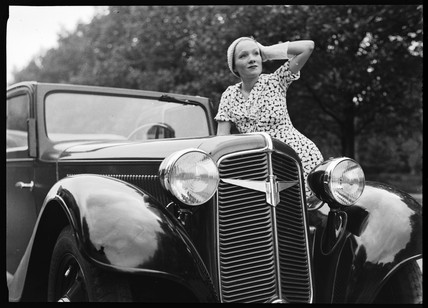 Woman beside an Adler motor car, Germany, c 1934.