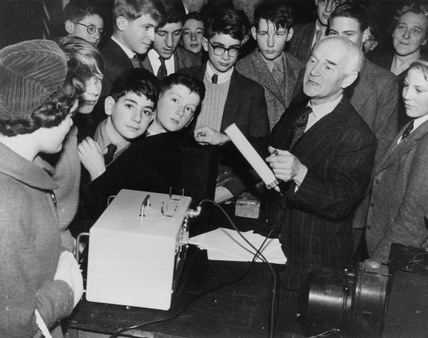 Dr T E Allibone demonstrating a Geiger counter, 1959.