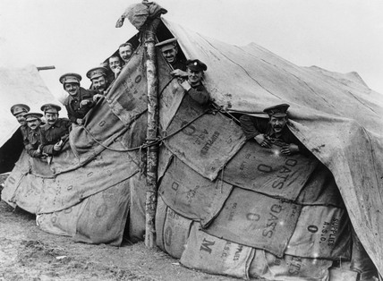 British soldiers looking out from their improvised tent, 1914-1918.