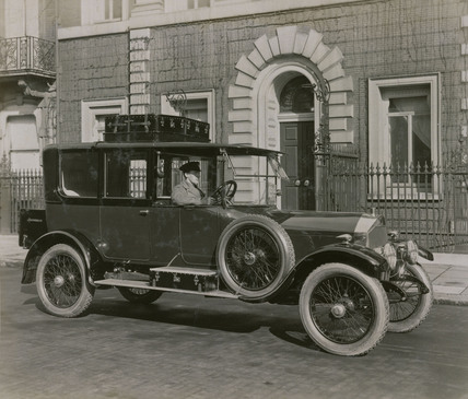 6 cylinder Cunard saloon with chauffeur, and luggage on roof rack