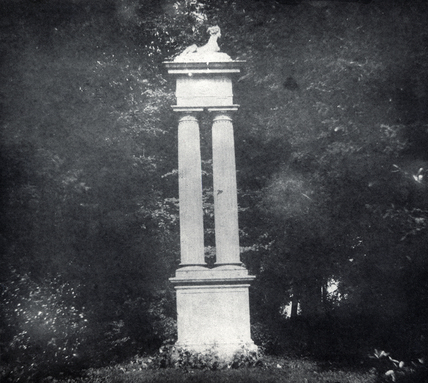 Statue on pillar in garden, Lacock Abbey , Wiltshire, 1840.