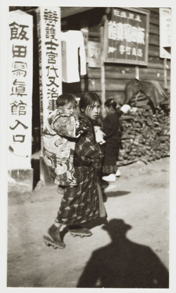 Chinese girl with baby, c 1905.
