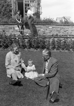 Family group in a garden, c 1948.