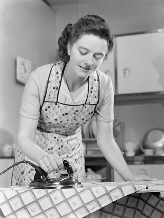 Woman Ironing In The Kitchen Late 1940s At Science And