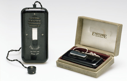 Two 'Emitome' hearing aids mid 20th century.