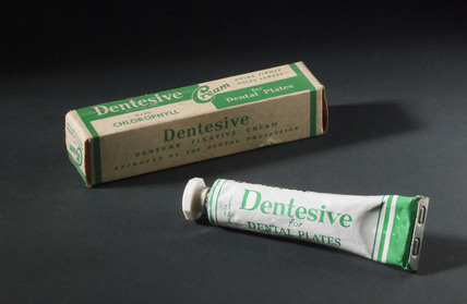 Two tubes, one boxed, of Dentesive denture fixative cream, 1950-1965.