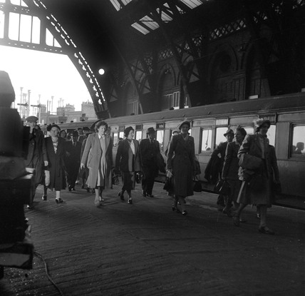 Passengers arriving at St Pancras station, London, 1950.