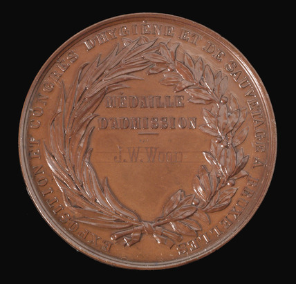 Ticket medal for admission to a health conference in Brussels, 1876.