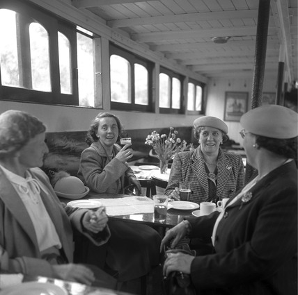 Women enjoying a glass of beer in the saloon of a river steamer, London, 1950.