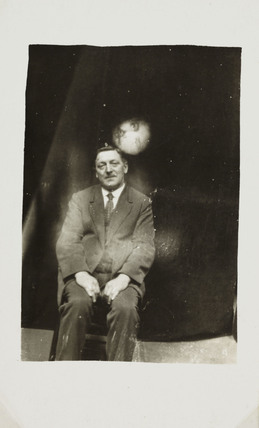 Man with 'spirit face' appearing, c 1920.