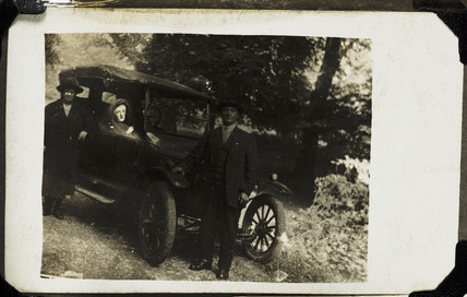 Couple with a 'spirit' in their car, c 1920..