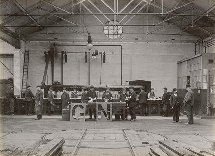 Workers using stencils, Doncaster works, South Yorkshire, c 1916.