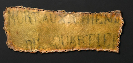 Human skin tattooed with inscription, probably French, 1850-1920.