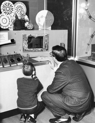 Visitors looking at an exhibit, Science Museum, London, 1948.