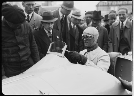Louis Chiron at the wheel of his Bugatti racing car, Berlin, 1933.