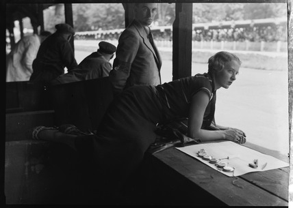 Female timekeeper at the AVUS race track, Berlin, 1933.