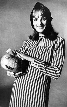 Model holding a pumpkin for Halloween, 30 October 1964.