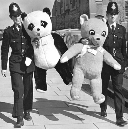 Policemen with giant cuddly toys, Brighton, March 1970.
