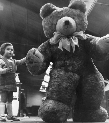 Child with giant teddy, Manchester, April 1966.