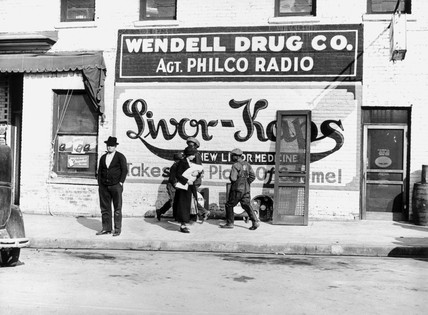 Advertisement on the side of a drugstore, North Carolina, 1939.