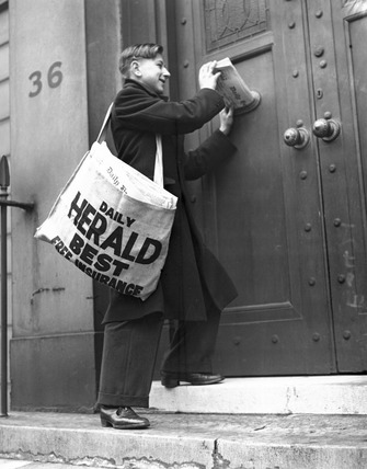 Newspaper boy delivering the 'Daily Herald', 13 December 1935.