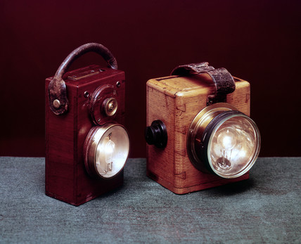 Electric battery-powered Swan safety lamps, British, early 20th century.