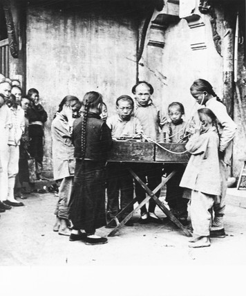 Chinese children listening to a gramophone,
