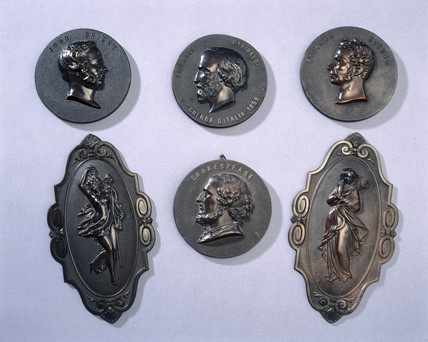 Six objects made from dark brown Bois Durci, c 1860.