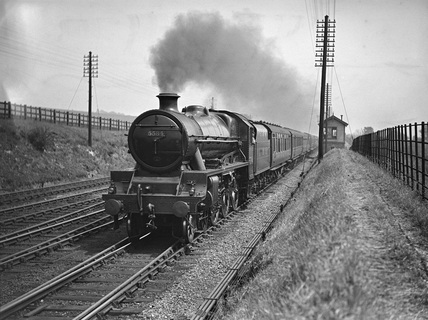 London Midland Scotland (LMS) class 5XP 4-6-0 no. 5584 'North West Frontier' at Bourne End. England, 1935.