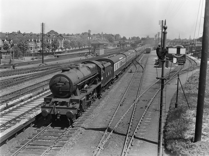 London Midland Scotland (LMS) rebuilt The Royal Scot 4-6-0 locomotive 46162 'Queen's Westminster Rifelman', West Ealing 19th May 1948.