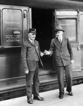The Admiralty chronometer being handed over by a railway guard on the arrival of the London