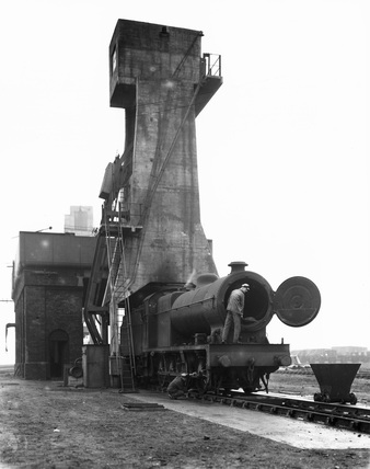 Coaling Tower loading coal into the tender, 1938.