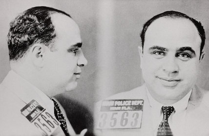 'The latest 'portrait' of Al 'Scarface' Capone, Chicago's gangland chief, from a recent rogue's gallery photograph made of him by the Miami police authorities.'