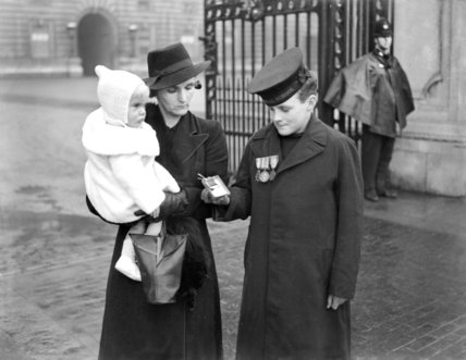 Boy wearing a British Empire Medal posthumously awarded his father - 16-October-1941