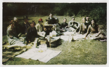 A group of people having a picnic.