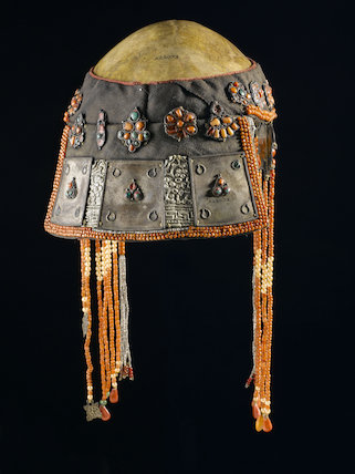 Ceremonial headdress with a human skull, Nepal, 19th century.
