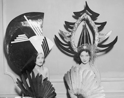 Two women modelling hats.