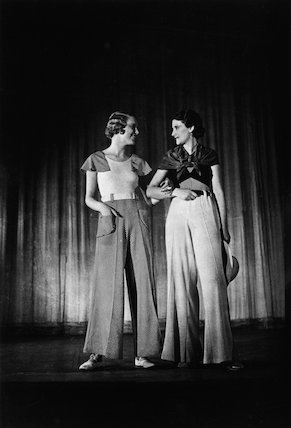 Two women on stage modelling.