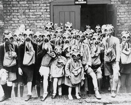Schoolchildren wearing gas masks for the first time.