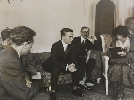 Charlie Chaplin being interviewed at the Ritz Hotel, London