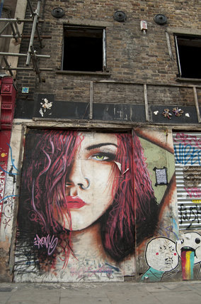 Graffiti portrait of girl in East London