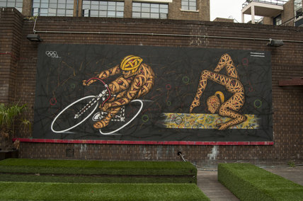 Graffiti of Olympic cyclist and gymnast by Otto Schade