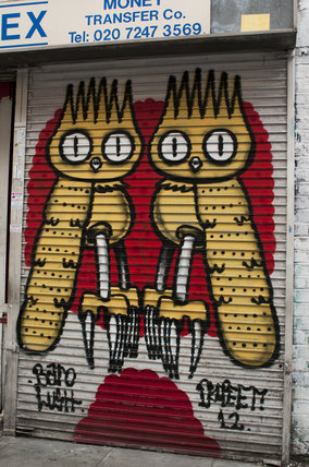 Graffiti in East London of owls by Dscreet
