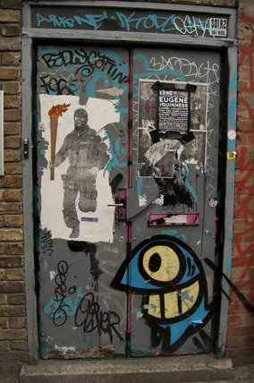Graffiti in East London on doorway on Redchurch Street