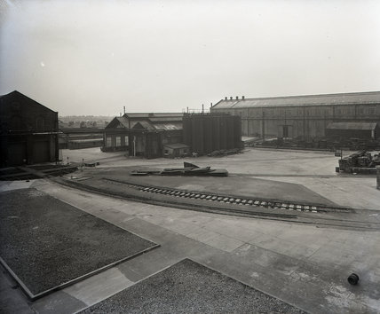Works photographic negative of exterior view of the boiler shop yard from the erecting shop, also showing the engine test sheds from the wheel shop, 1959.
